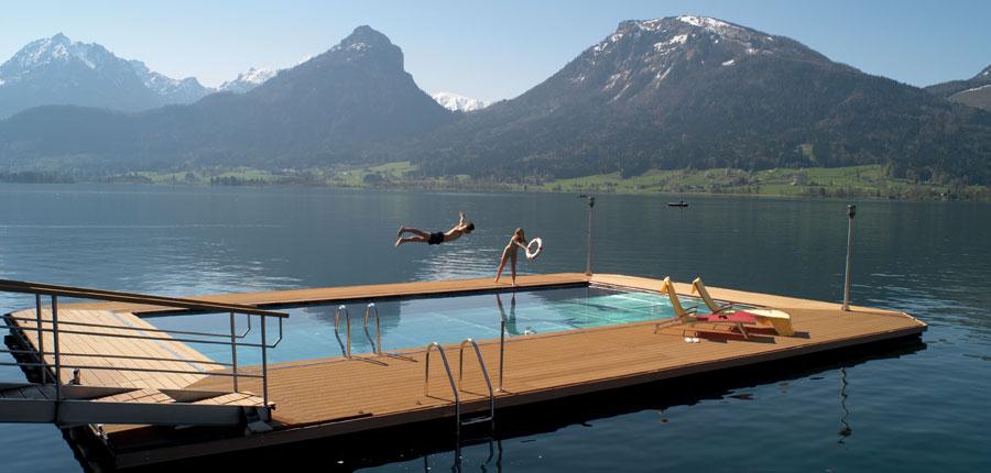 Romantik Hotel Weisses Rössl, St. Wolfgang, Salzkammergut, Austria - Man jumping in heated lake swimming area..jpg